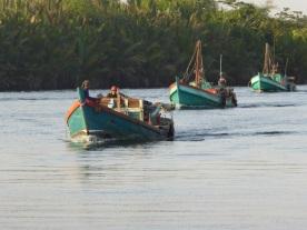 Fishing boats heading to sea