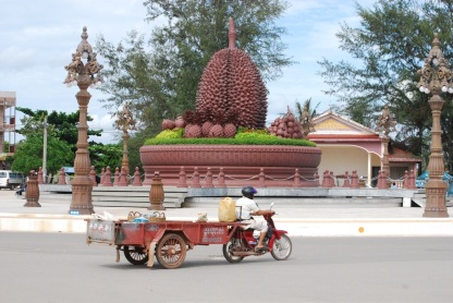 """The durian roundabout. The bike is pulling a """"country bus"""" cart."""